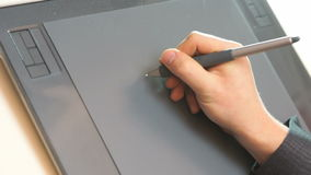 Hand drawing on tablet stock video footage