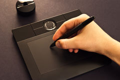 Hand on drawing tablet Stock Photos
