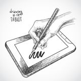 Hand drawing on the tablet Royalty Free Stock Photography