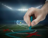 Hand drawing tactics on football pitch Stock Photos
