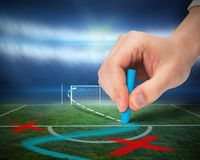 Hand drawing tactics on football pitch Royalty Free Stock Photos