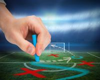 Hand drawing tactics on football pitch Royalty Free Stock Image