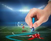 Hand drawing tactics on football pitch during match Royalty Free Stock Photography