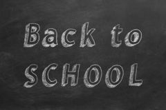 Back to School. Hand drawing text `Back to School` on blackboard vector illustration