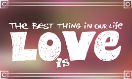 Hand drawing text  The best thing in our life is love  on blurred pink background Royalty Free Stock Photography