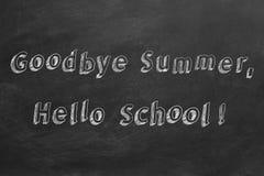 Goodbye Summer, Hello School. Hand drawing text `Goodbye Summer, Hello School!` on blackboard stock illustration