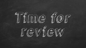 Time for review. Hand drawing `Time for review` on black chalkboard. Stop motion animation stock illustration