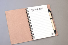Hand drawing wish list on notebook Royalty Free Stock Photography