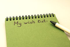 Hand drawing wish list on notebook Stock Photography
