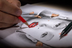 Hand Drawing. A Woman Face with Pencil royalty free stock photos