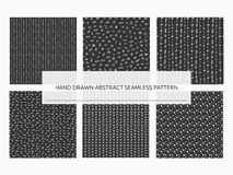 Hand drawn abstract seamless pattern set. Vector trendy print co. Llection. Lines, stripes, spots, hearts, dots, geometric symbols. White and black Royalty Free Stock Photography