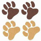 Hand drawn acrylic paw prints on a white background stock illustration