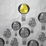 Hand drawn air balloons with 3d metal brain. On crumpled paper as leadership concept Stock Photo