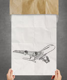 Hand drawn airplane on crumpled paper Royalty Free Stock Photos