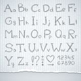 Hand drawn alphabet. And figures on gray paper Stock Images