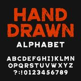 Hand drawn alphabet font. Distressed letters and numbers on a dark background. Stock Photos