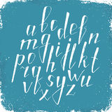 Hand drawn alphabet. Handmade letters. Handwritten alphabet on blue grunge background. Hand drawn calligraphy. Modern chalk typography Royalty Free Stock Photo
