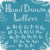 Hand drawn alphabet. Handmade letters. Handwritten alphabet on blue grunge background. Hand drawn calligraphy. Modern chalk typography Royalty Free Stock Photos