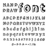 Hand drawn alphabet. Handwritten font. Doodle - Letters, uppercase, lowercase, numbers, digits, symbols set. Isolated in white background Stock Images