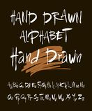 Hand drawn alphabet in retro style. ABC for your design. Letters of the alphabet written with a brush. Black background. Stock Images