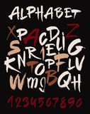 Hand drawn alphabet in retro style. ABC for your design. Letters of the alphabet written with a brush. Dark background. Hand drawn alphabet in retro style. ABC Stock Photo