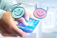 Hand drawn angel and devil icon going out a smartphone interface Stock Photos
