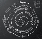 Hand drawn arrow icons set on black chalk board Stock Images