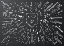 Hand drawn arrow icons set on black chalk board Stock Photo