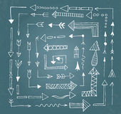 Hand drawn arrow icons set on blue chalk board Stock Photography