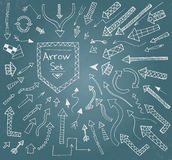 Hand drawn arrow icons set on blue chalk board Royalty Free Stock Image