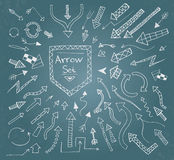 Hand drawn arrow icons set on blue chalk board Royalty Free Stock Photography