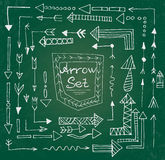 Hand drawn arrow icons set on green chalk board Royalty Free Stock Photo