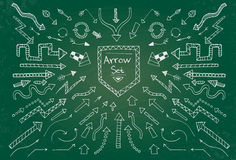Hand drawn arrow icons set on green chalk board Stock Photo