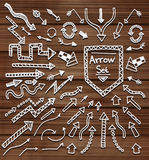 Hand drawn arrow icons set on wooden texture Royalty Free Stock Photo