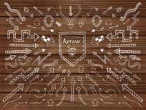 Hand drawn arrow icons set on wooden texture Stock Photography
