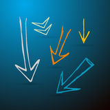 Hand Drawn Arrows Set. Hand Drawn Arrows on Dark Blue Background Royalty Free Stock Photos