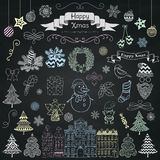 Hand Drawn Artistic Christmas Doodle Icons on Chalk Board Texture Royalty Free Stock Image