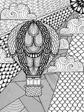 Hand drawn artistically ethnic ornamental patterned air balloon. In clouds in doodle, zentangle tribal style for adult coloring book, pages, tattoo, t-shirt or Stock Images