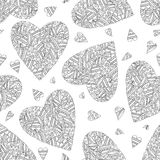 Hand drawn artistically ethnic ornamental seamless pattern with heart Stock Images