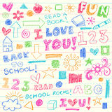 Hand-Drawn Back to School Crayon Doodle Elements. Hand-Drawn Back to School Crayon Doodles with Hand Drawn Lettering and lots icons including books, a house, sun Royalty Free Stock Images