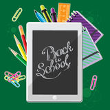 Hand drawn back to school lettering with set of  supplies and computer tablet. Vector illustration Stock Photos