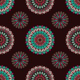Hand drawn background with decorative elements in brown, blue and red colors. Mandala colorful vector seamless pattern. Abstract geometric texture. Hand drawn royalty free illustration