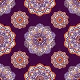 Hand drawn background with decorative elements in purple, violet and orange colors. Mandala colorful vector seamless pattern. Abstract geometric texture. Hand stock illustration