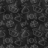 Hand drawn background with hand drawn gifts, cake, candy on the black chalkboard. Series of Cartoon, Doodle, Sketch and Hand drawn Seamless Patterns Stock Photos