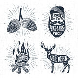 Hand drawn badges set with acorns, bearded face, bonfire, and deer illustrations. Stock Photography