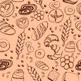 Hand drawn bakery on cream-colored background. Seamless pattern background. Stock Photography