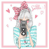 Hand drawn beautiful cute girl with camera in hands. royalty free illustration