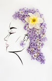 Hand drawn beautiful female profile with natural narcissus flower hairstyle Stock Images
