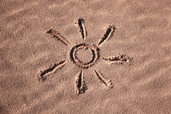 Hand drawn beautiful sun symbol on the sand Royalty Free Stock Photography