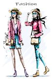 Hand drawn beautiful young girls in hats. Two stylish women. Fashion woman look. Sketch vector illustration